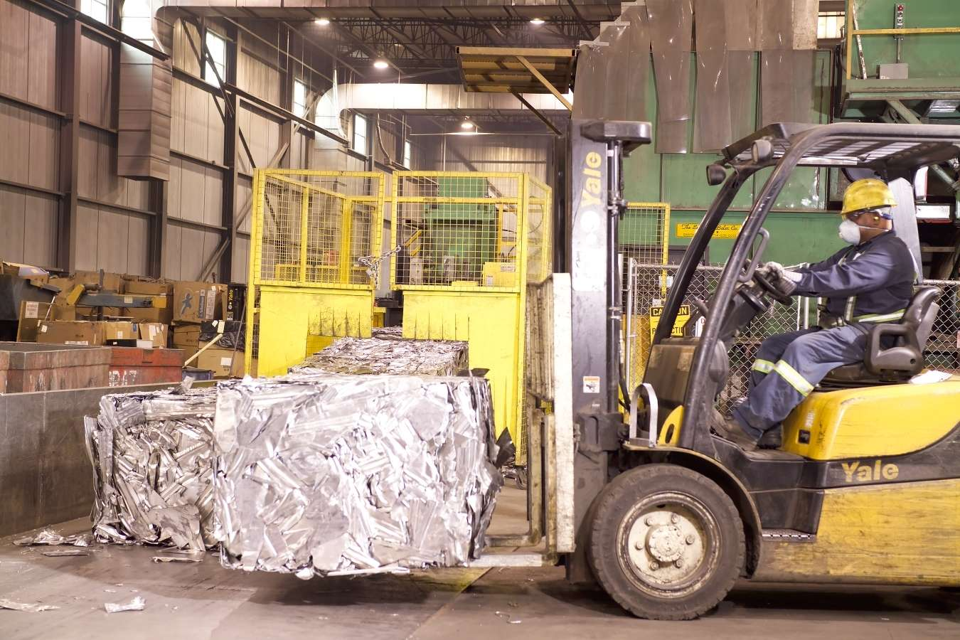 Forklift transporting scrap metal for recycling